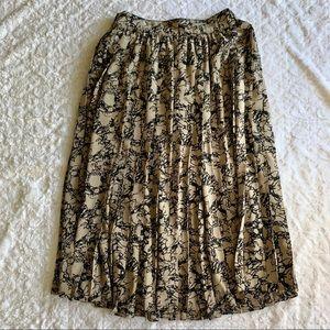 Long Tan and black skirt